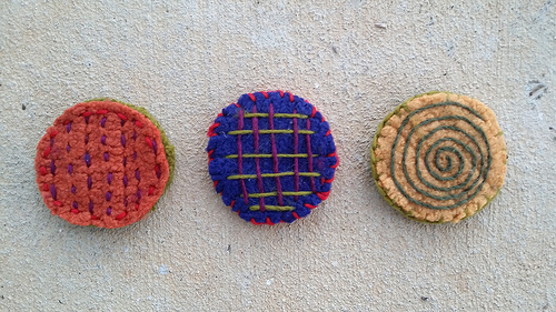 three felted crochet circles