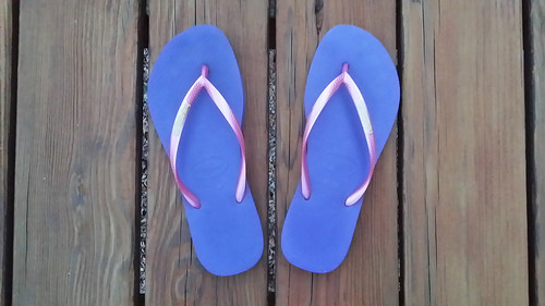 purple and pink flip flops