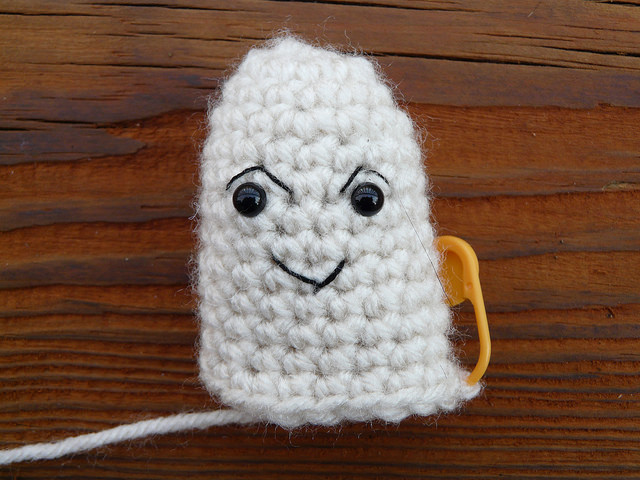 The face of a crochet banana amigurumi