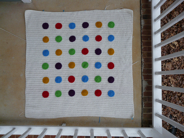 A crochet blanket based on the game DOTS