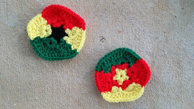 crochet pentagons for a crochet soccer ball inspired by the flags of Ghana and Cameroon