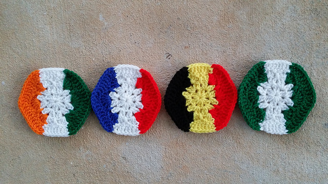 Crochet hexagons for a crochet soccer ball inspired by the vertical stripe flags of Cote d'Ivoire, France, Belgium, and Nigeria