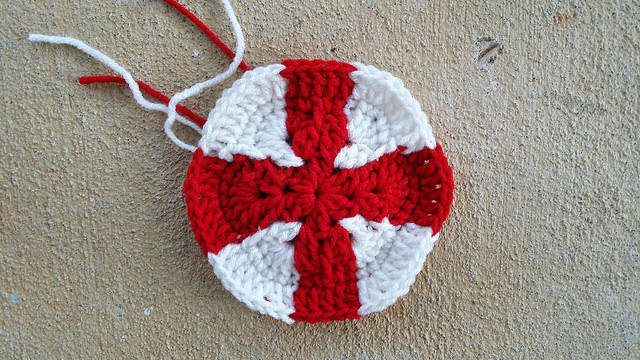 a crochet hexagon inspired by the flag of England for a crochet soccer ball