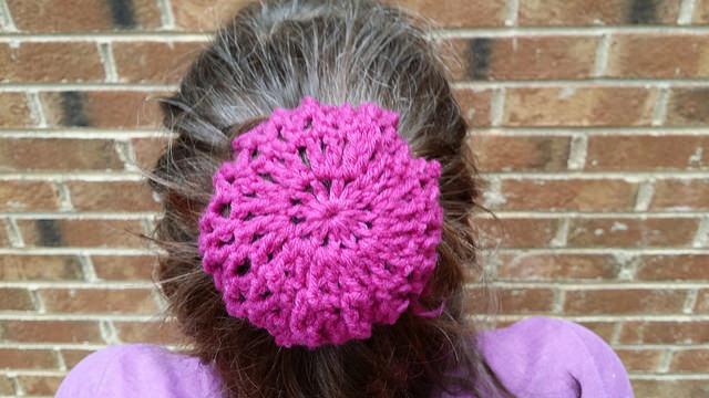 magenta crochet bun cover