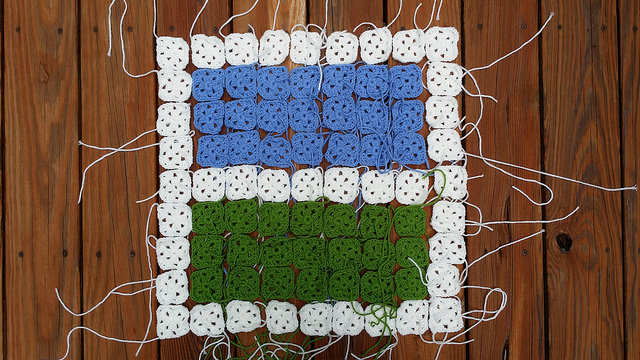 a room with a view rendered in granny squares