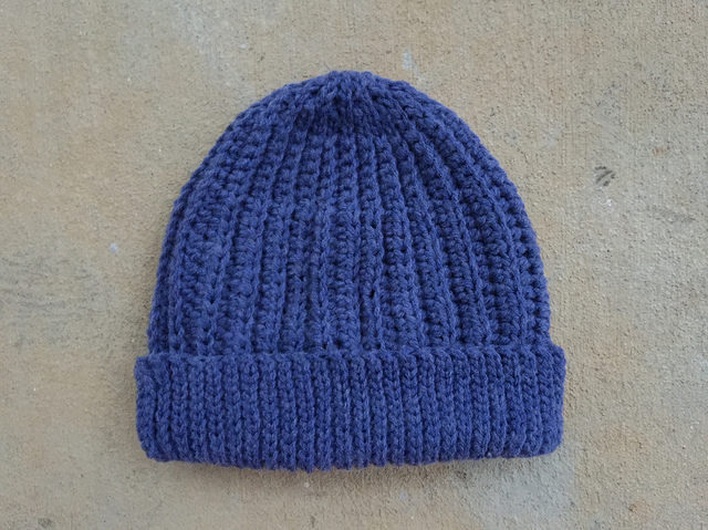 A skein of vintage yarn transformed into a crochet hat; the first of two more hats
