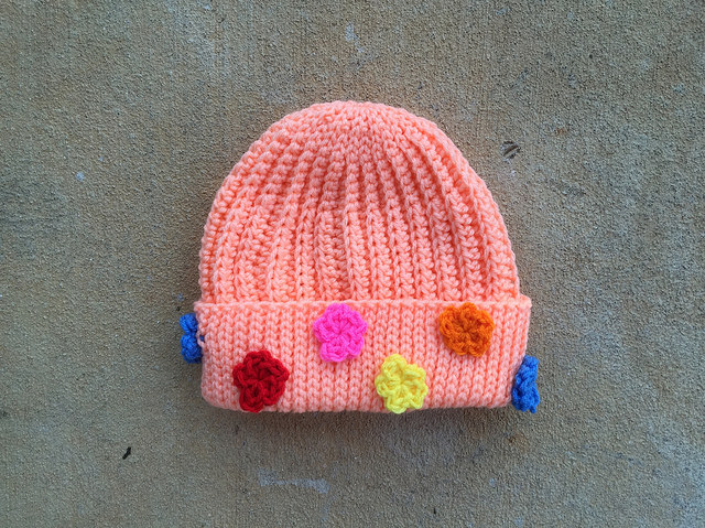 Peachy keen seafarer's cap with flowers
