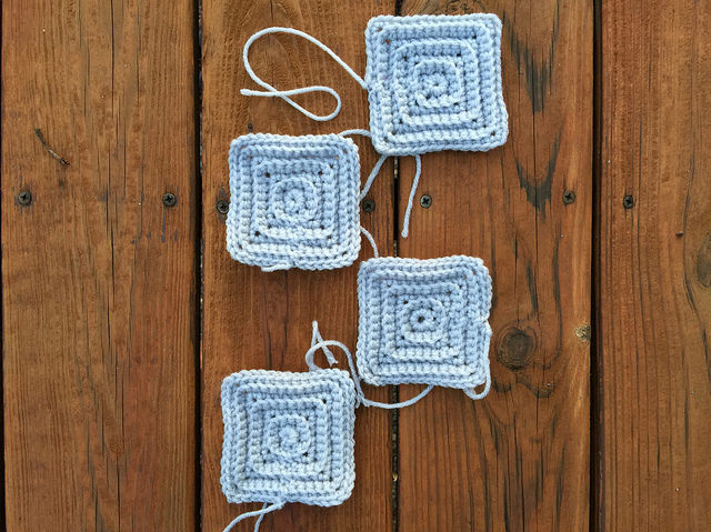 Four gray textured crochet squares worked at a slightly slower pace