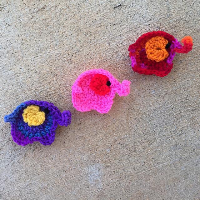 three crochet elephants on parade