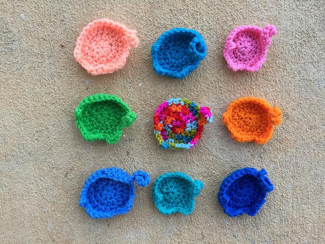 nine crochet elephants