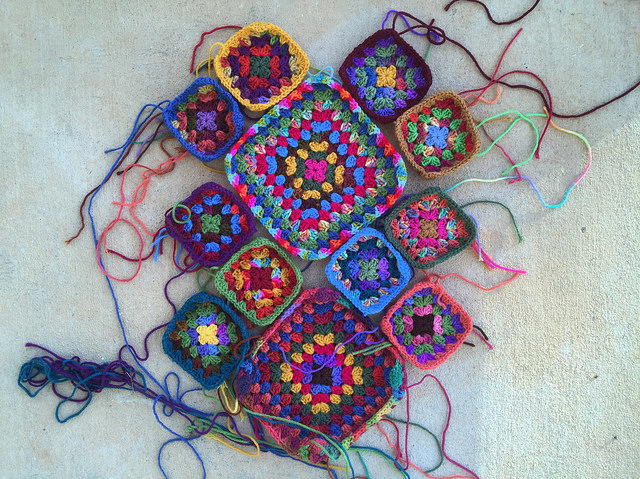 twelve assorted granny squares