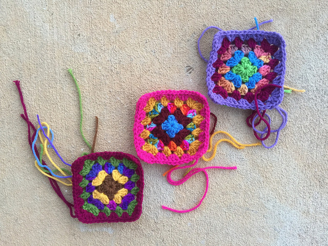 Three recently completed granny squares