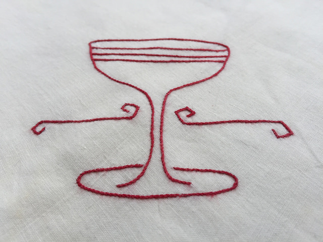 Detail of an embroidered tea towel