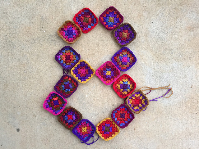 sixteen granny squares for a crochet purse