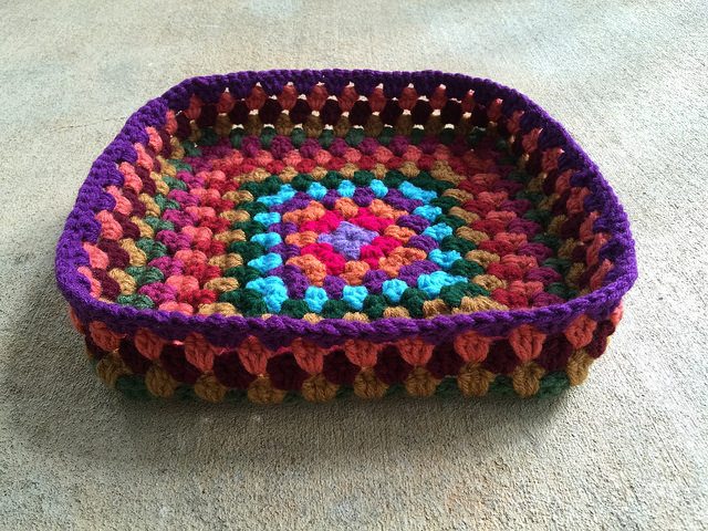 I make progress granny square crochet basket by trimming all of the ends