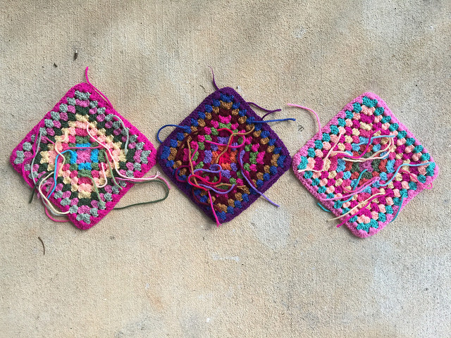 three ten-round granny squares crochet squares