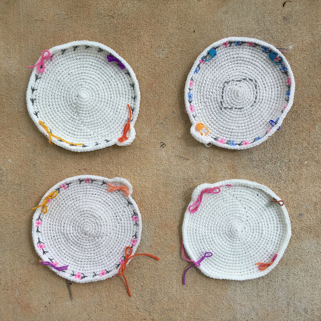 four crochet circle motifs with embroidery