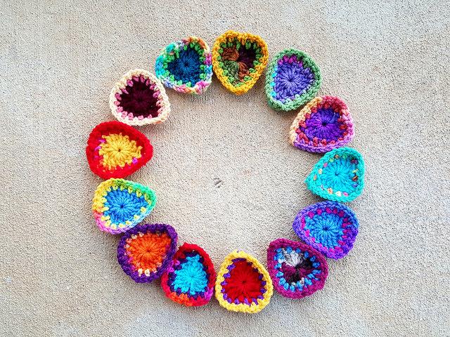 a circle of thirteen crochet hearts