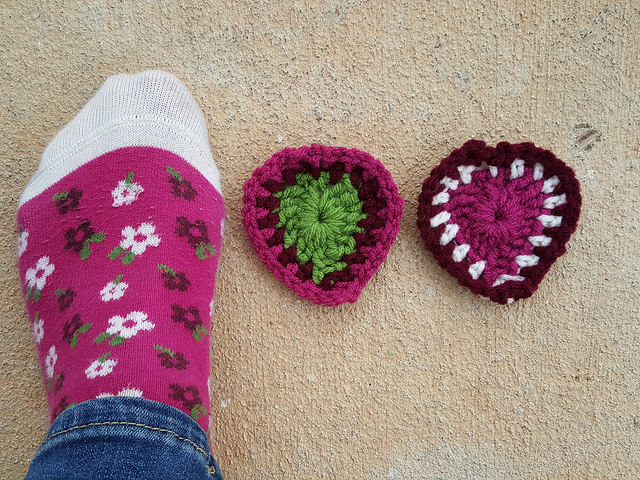 the finished crochet hearts with coordinating socks at the end of the color study
