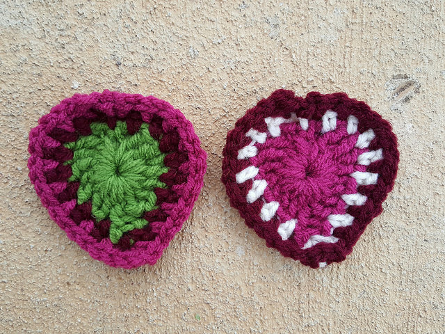 two boho crochet hearts made as part of a color study