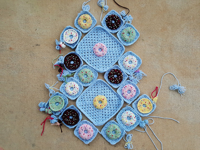 the pieces of a crochet donut granny square purse