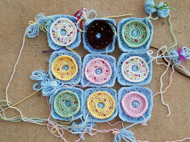 nine crochet donut granny squares with embroidery sprinkles