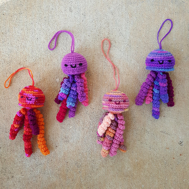 A bloom of four crochet jellyfish amigurumi