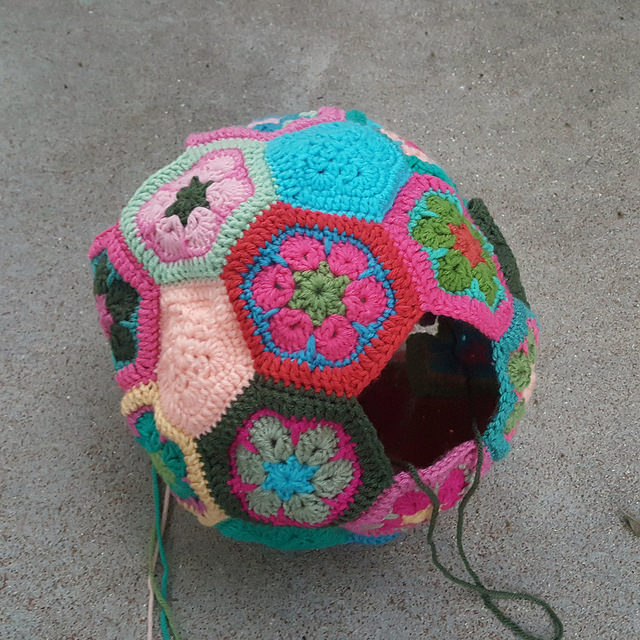 a nearly assembled crochet soccer ball nearly ready for some stuffing