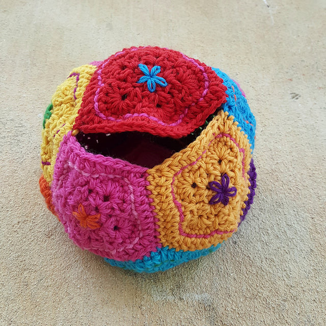 A wool dodecahedron with the ends woven in and almost ready to be f