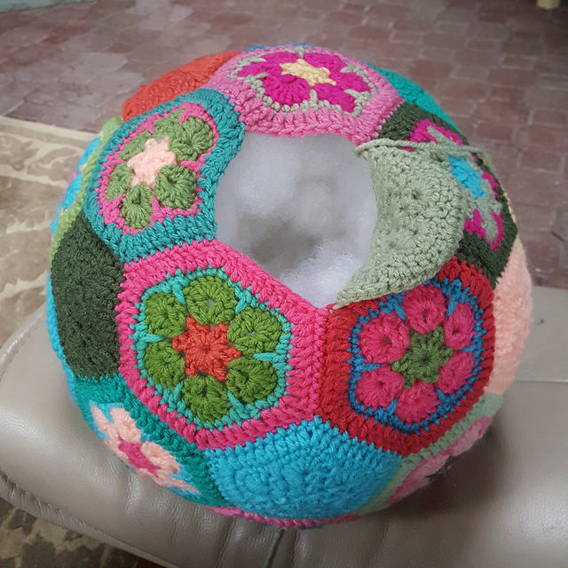 A crochet soccer ball nearly stuffed