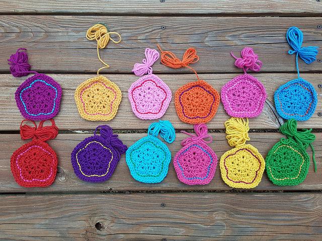twelve completed crochet flower pentagons