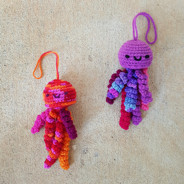 two crochet jellyfish amigurumi form the start of a bloom