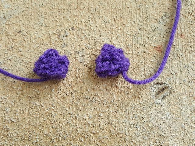 Two crochet mink ears for a vegan mink