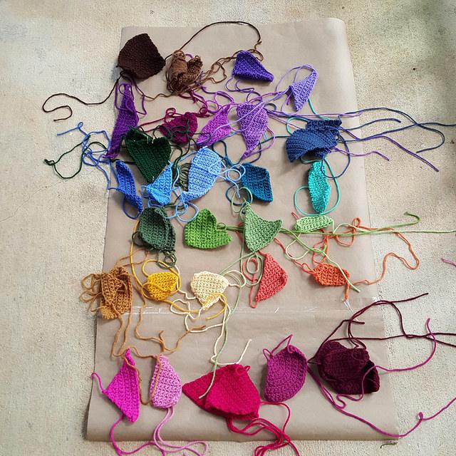crochet crazy quilt pieces organized by color