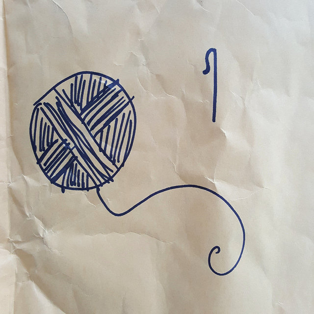 drawing of a ball of yarn and a crochet hook