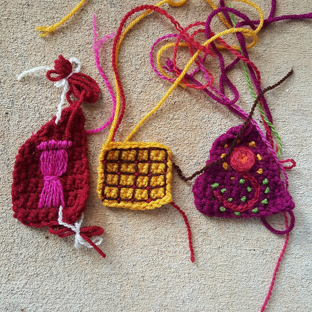 crochet pieces with bullion stitches and other embroidery