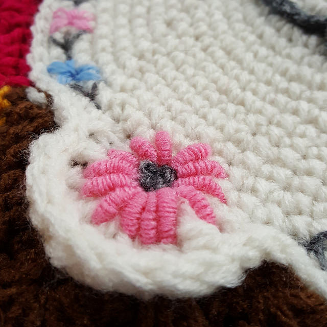 flower embroidered on a crochet piece
