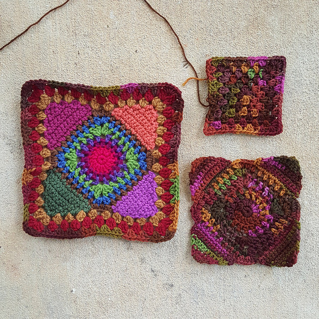 Three pieces of a bag-to-be in various stages of completion