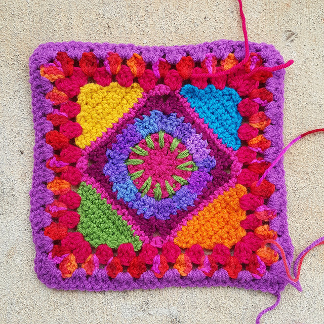 A crochet granny square with ends to be woven in