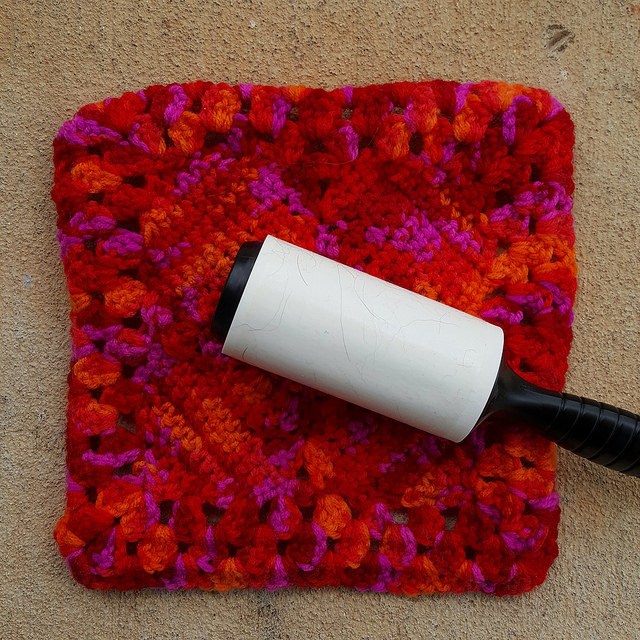 Removing dog and cat hair from a crochet granny square