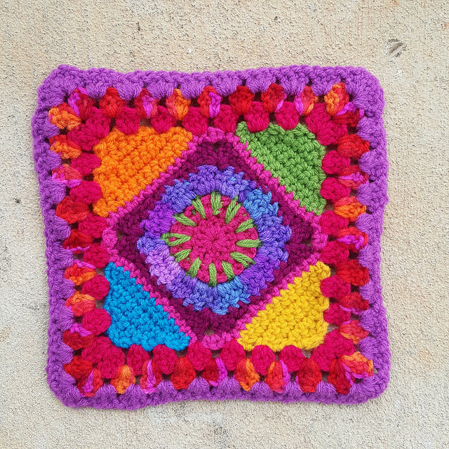 The same crochet granny square with the ends woven in