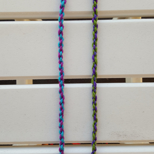 lengths of twisted yarn for a crochet purse strap