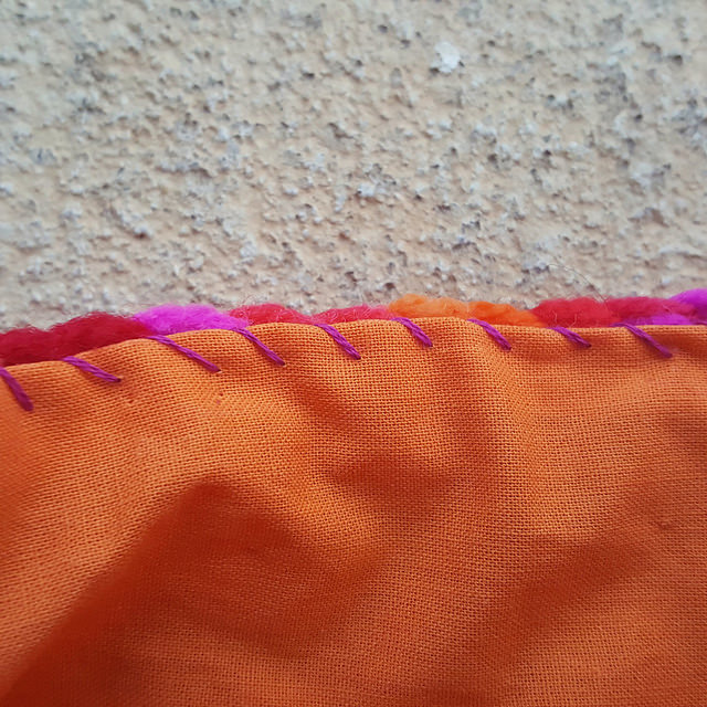 sewing a fabric lining into a crochet bag