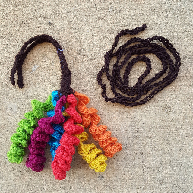 to be felted hyperbolic crochet curlicue tassel and chain