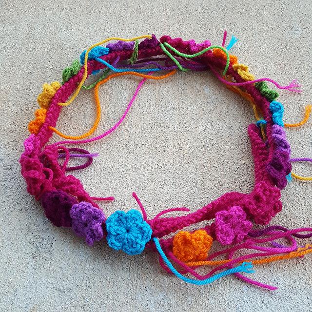 a crochet flower festooned purse strap