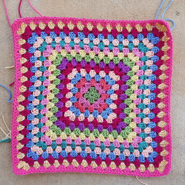 granny square crochet blanket with an irrepressible shade of pink