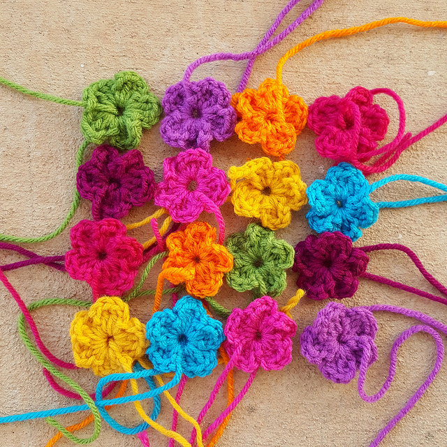 Sixteen crochet flowers