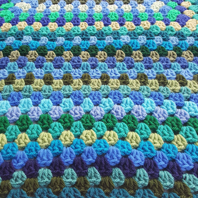 crochet rows of blues and greens