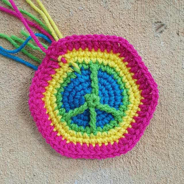 A final peace sign crochet hexagon for a crochet soccer ball