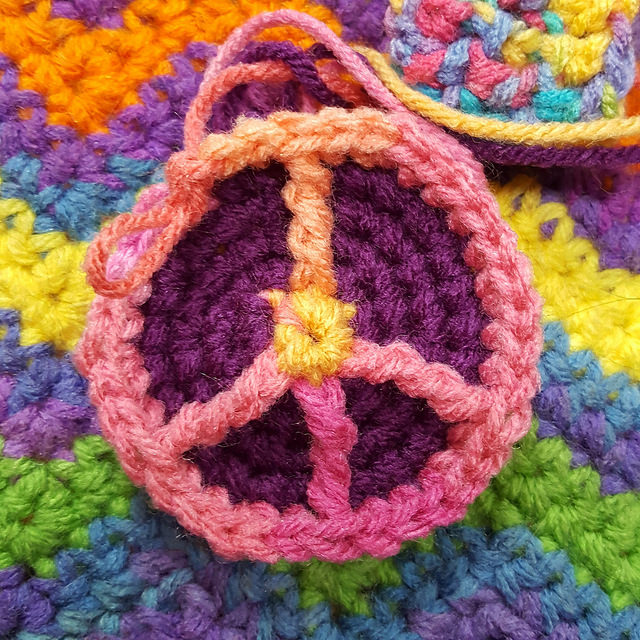 My second, somewhat groovier peace sign crochet hexagon for a crochet soccer ball